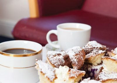 Relax with a hot drink and a cake in our Visitors Lounge at Lukestone Care Home.