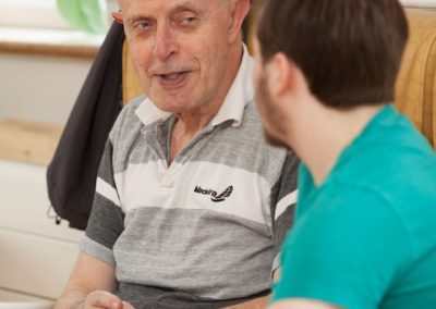 Our Activities Co-ordinator Dominic having a chat with one of our residents.