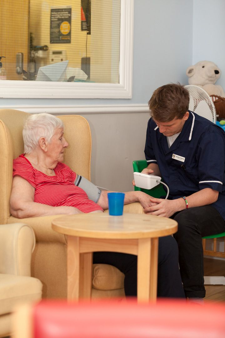Our Nurse Stefan with one of our residents in the lounge.