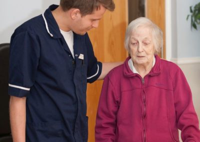 Our Nurse Stefan chatting with residents in the lounge.