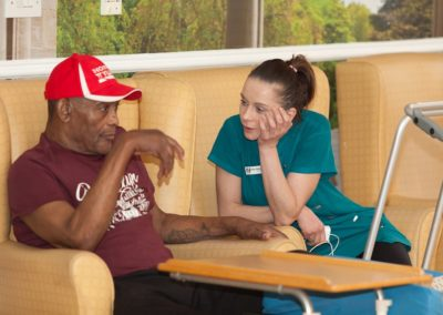 Our Activities Co-ordinator Ewa having a chat with one of our residents.