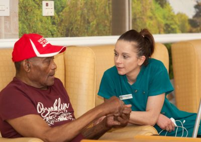 Our Activities Co-ordinator Ewa having a chat with one of our residents