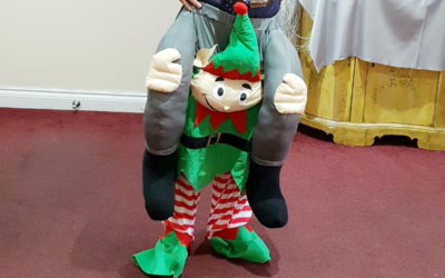 Manager Mario at Princess Christian Care Home, in an elf fancy dress costume