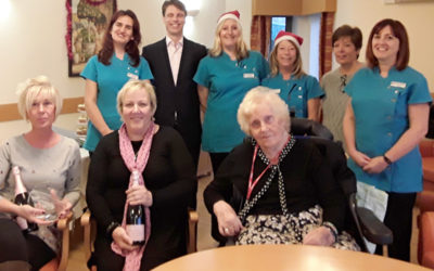 The Hengist Field Care Home team receiving an award for their effort with their local community