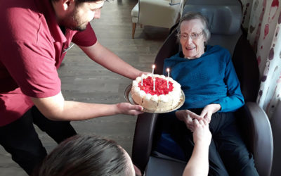 Abbotsleigh Care Home lady resident receiving a birthday cake