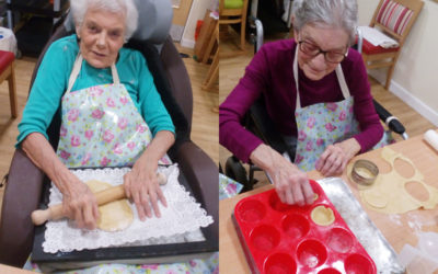 Two female Hengist Field Care Home residents rolling and cutting pastry to make jam tarts