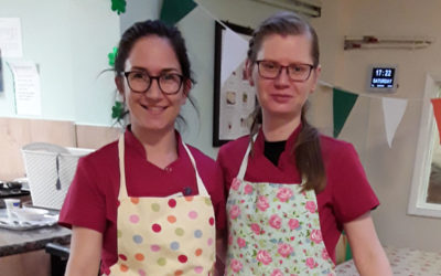 Two staff at Lulworth House Residential Care Home in aprons