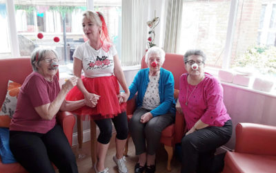 Staff and residents in red noses on Red Nose Day
