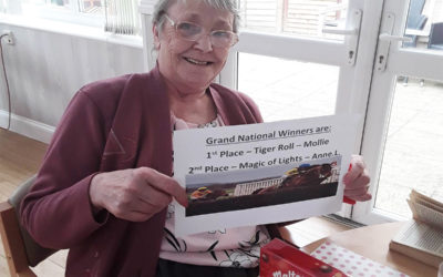 Lady resident at Woodstock Residential Care Home with her Grand National chocolate prize