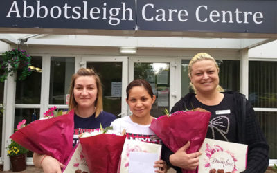 Nurses from Abbotsleigh Care Home with flower and chocolate gifts on International Nursing Day
