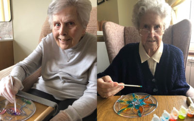 Ladies at Silverpoint Court painting sun catchers