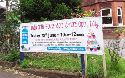 Front of Lulworth House with a banner promoting their Open Day