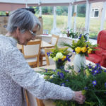 Lady resident arranging flowers at Loose Valley Care Home