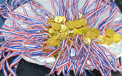 A tray of medals for the sports day at Lukestone Care Home