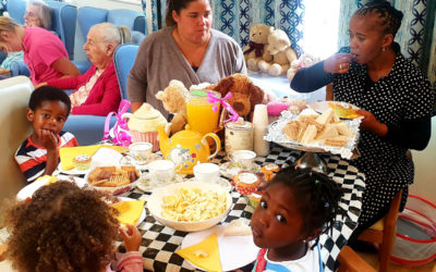 Nursery children and staff enjoying a tea party with teddies at Lukestone Care Home