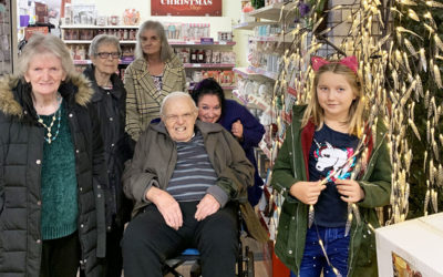 Lulworth residents and staff in a shop with Christmas decorations