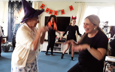 Residents being entertained by Halloween dancers