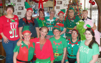 The staff team at Woodstock dressed up as Christmas elves